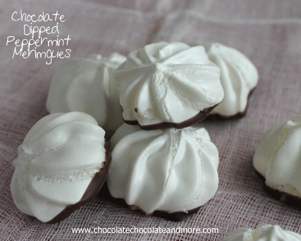 Chocolate Dipped Peppermint Meringues-the lightness of a Meringue with just the hint of peppermint complemented with a light dip in chocolate.