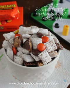 Loaded Peanut Butter Muddy Buddies Snack Mix-with Reeses Pieces and Reeses Peanut Butter Cups your family will eat it up!