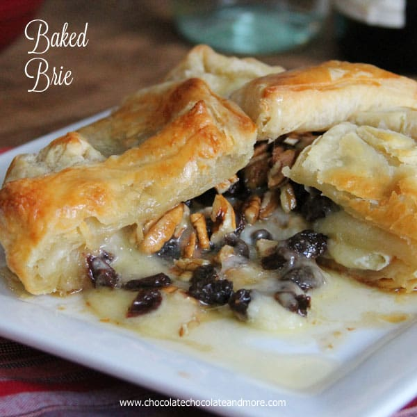 Baked Brie topped with rum soaked raisins, pecans and just a touch of maple syrup. then wrapped in a flaky puff pastry.
