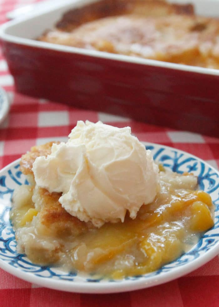 Simple Peach Cobbler-made with just a few ingredients, this cobbler magically transforms creating a crispy, buttery crust on top with sweet juicy peaches inside!