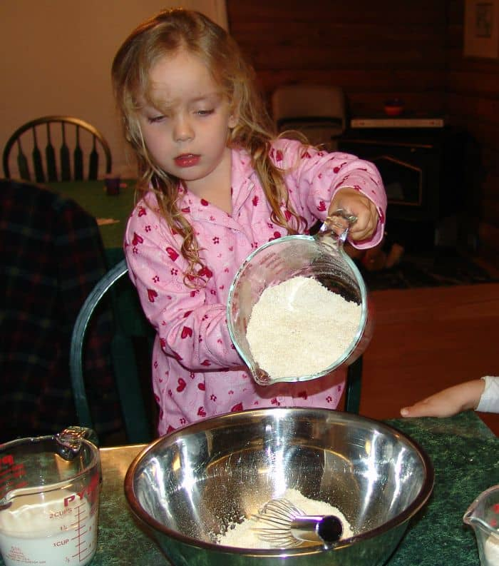 Grace cooking at age 4