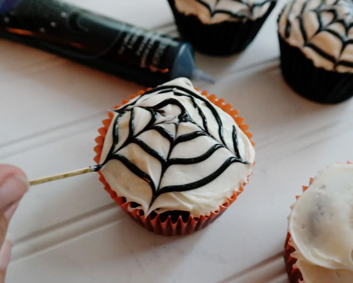 Make Spider Web Cupcakes with a swirl of black icing and a toothpick!