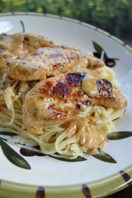 Chicken Lazone from Plain Chicken takes about 15 minutes to make, seared chicken tenders with a creamy sauce, perfect for serving with pasta or mashed potatoes!