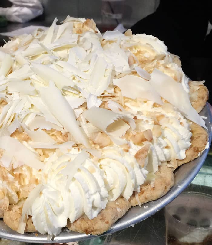 Coconut Cream Pie topped with white chocolate shavings