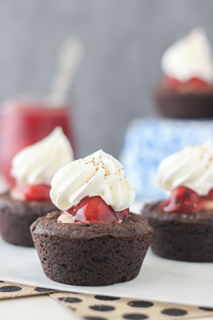 These Black Forest Cookie Cups are a decadent chocolate pudding cookie filled with chocolate mousse, cherry pie filling and whipped cream.