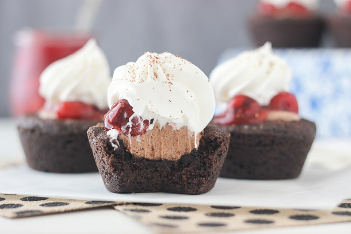 Gooey chocolate cookies with a fluffy chocolate mousse topped with cherry pie filling and whipped cream. You will enjoy every bite of these Black Forest Cookie Cups.