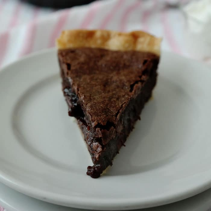 Easy Brownie Pie-taking brownies to the next level and creating an easy dessert-a flaky pie crust surrounds a rich brownie with a thin crust on top and in the middle a gooey, fudgy delight!
