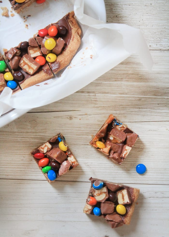 Leftover Halloween Candy Bars have a shortbread base, a layer of gooey melted chocolate chips, and then all the Halloween candy you can throw at 'em. How could that be a bad thing?