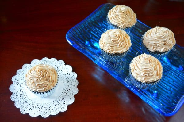 Enjoy a plate of chocolate cupcakes with Chai Buttercream Frosting