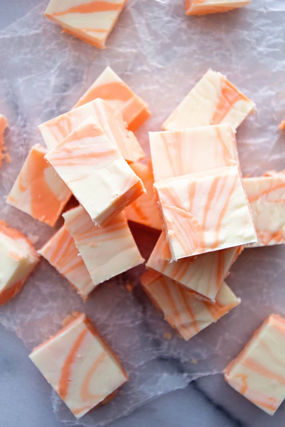 Easy Orange Creamsicle Fudge ~ This Fool Proof Fudge will have everyone thinking you slaved over it! Super Simple, Smooth, Creamy Fudge!