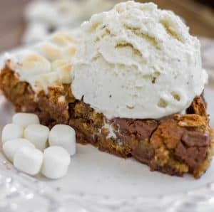 S'mores Skillet Cookie - A brown sugar cookie filled to the brim with chopped Hershey bars, marshmallows and graham crackers.