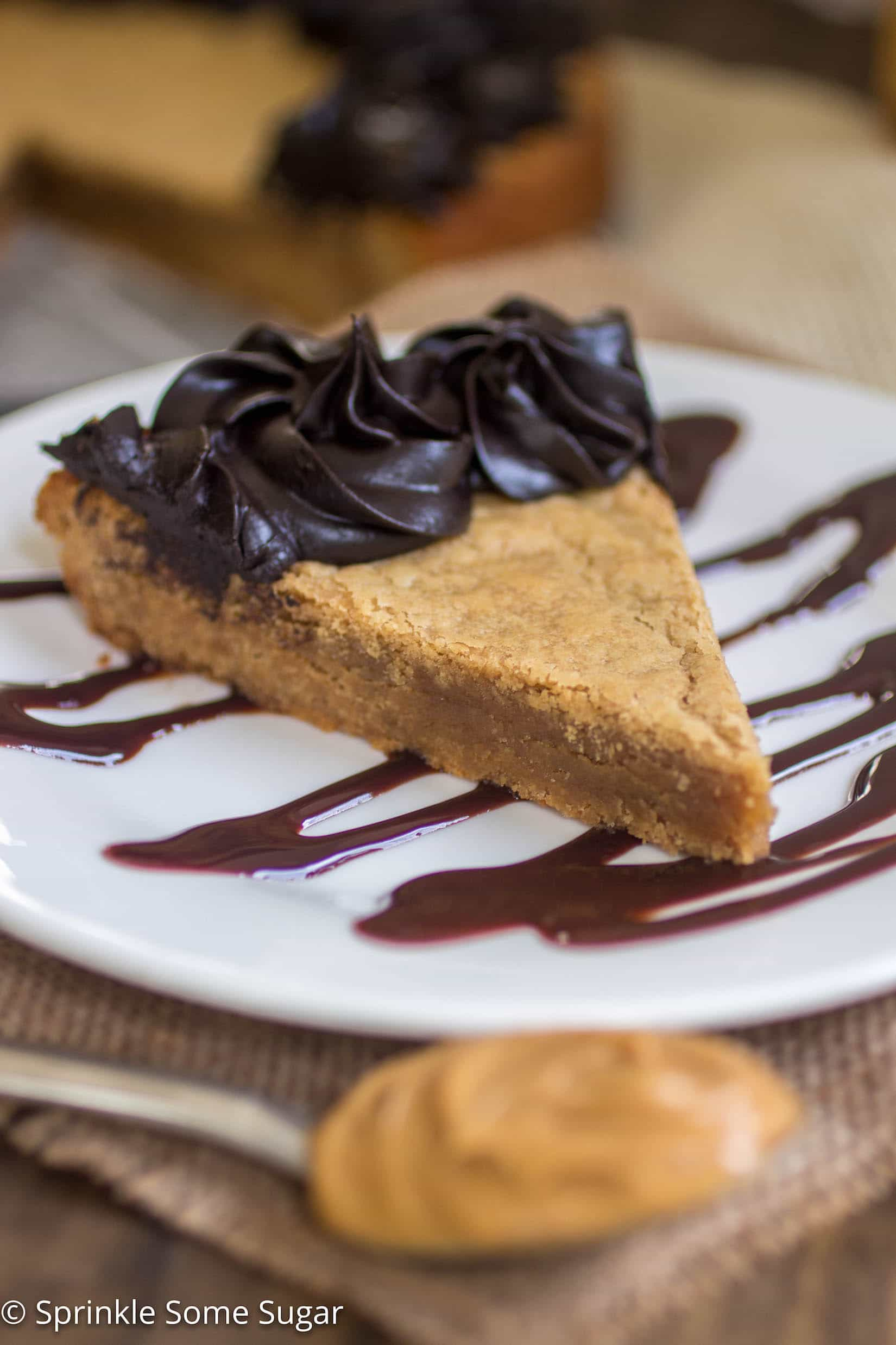 Peanut Butter Cookie Cake - A thick, chewy peanut butter cookie cake topped with a creamy dark chocolate frosting.