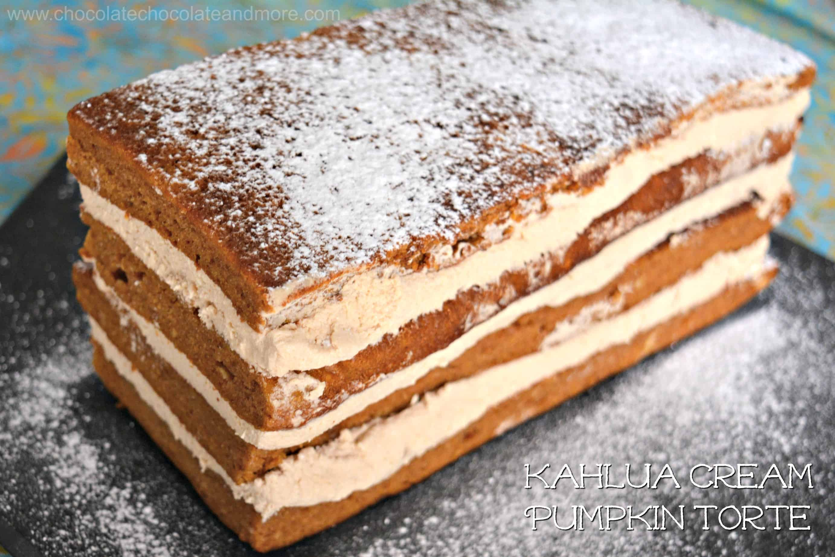 a rectangular cake made up of stacks of layers of spice cake filled with layers of cream and dusted with powdered sugar