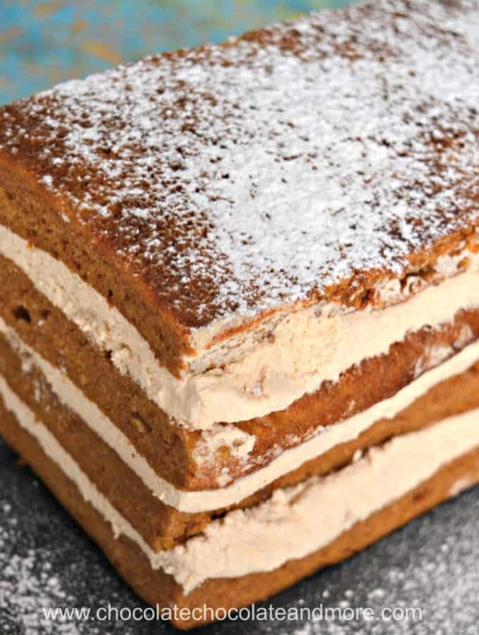 a rectangular cake made of layers of spice cake and cream