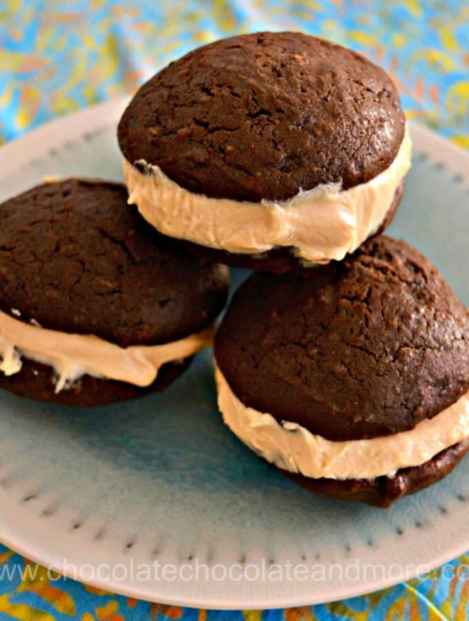 three sets of chocolate cookies sandwiched together with peanut butter cream