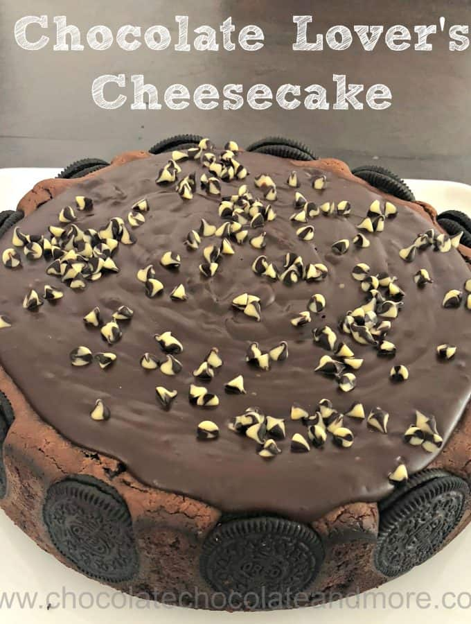 a large chocolate cheesecake covered with chocolate ganache and surrounded by oreos in the crust
