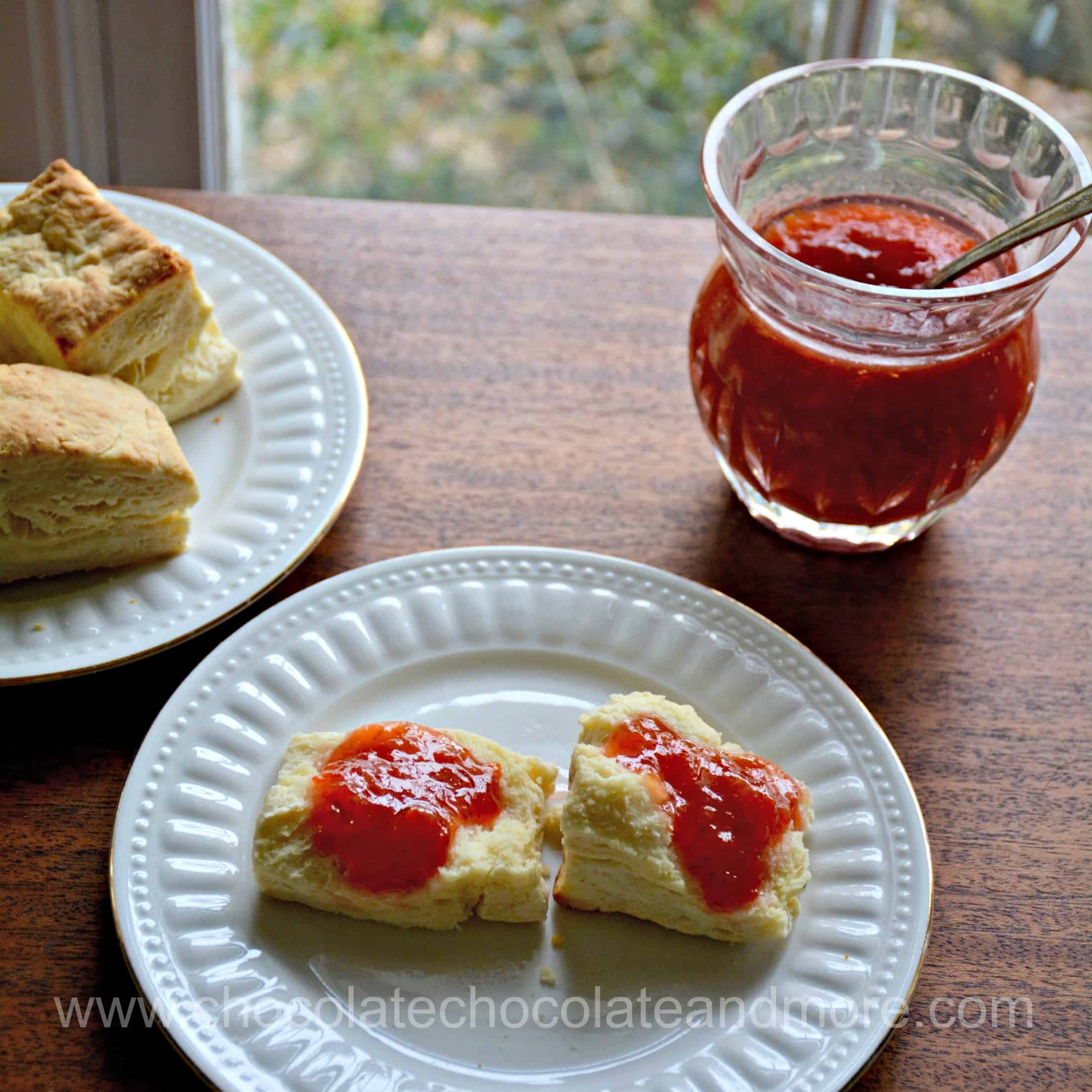 raspberry grapefruit marmalade on a pastry with a bowl of it on the table