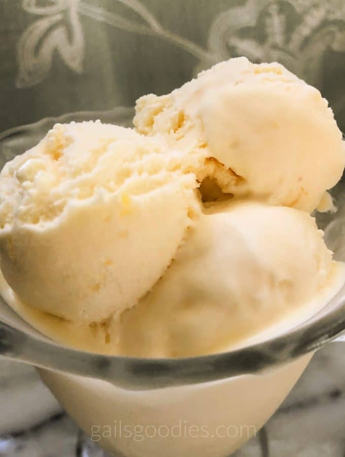 a glass bowl with several scoops of melting ice cream