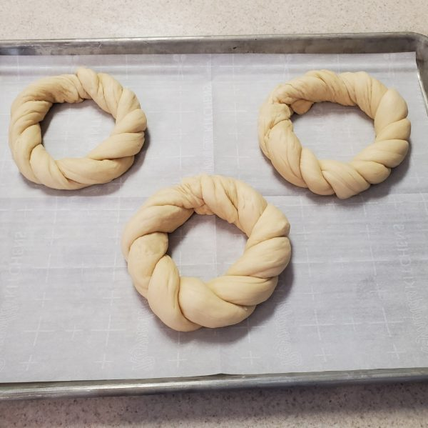 three twisted rings of raw bread dough