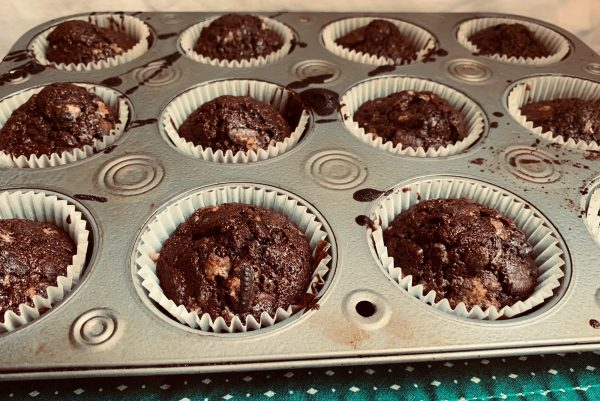 A cupcake tray of unfrosted Oreo Brownie Cups fresh out of the oven.