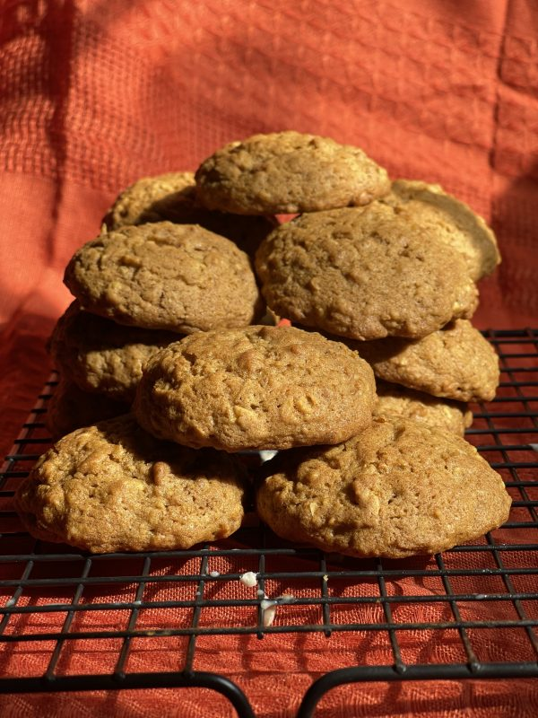 Pumpkin Spice Oatmeal Cookies stacked on the cooling rack