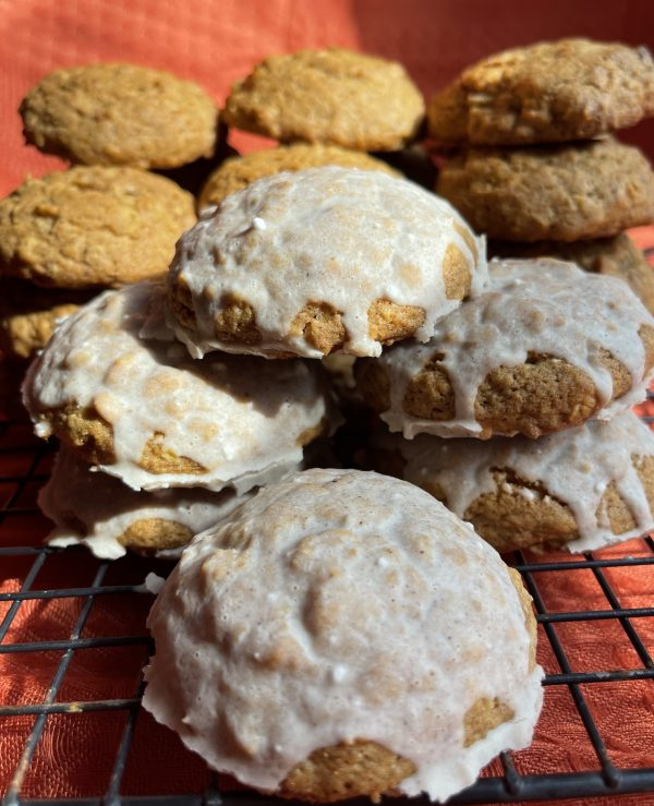 Pumpkin Spice Oatmeal Cookies stacked on a cooling rack.