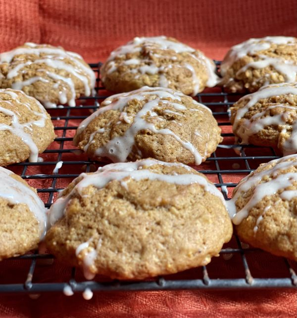 9 Pumpkin Spice Oatmeal Cookies sitting on the cooling rack.