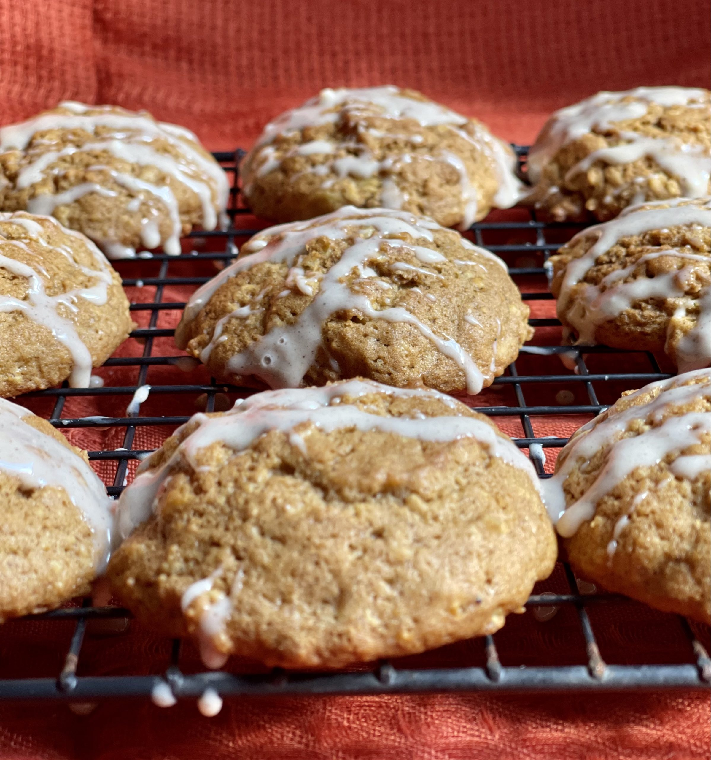 Pumpkin Spice Oatmeal Cookies - Pumpkin, Pumpkin Spice, and Oatmeal all combined to make a delicious fall treat, and a sweet Pumpkin Spice glaze on top to bring it all together! via @chocolatemore